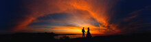 Couple In Love On Sunset Backg...
