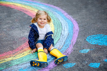 Happy Little Toddler Girl In R...