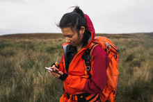 Woman Hiking In Scotland