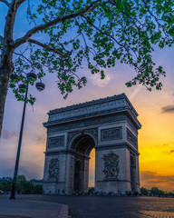 Fototapeta na wymiar View of the famous Triumphal Arch. The Arc de Triomphe honours those who fought and died for France in the French Revolutionary and Napoleonic Wars.
