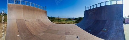 view of a ramp in the skatepark for skateboards and in line skates Canvas