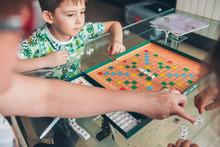 Little Boy Is Playing Board. ...