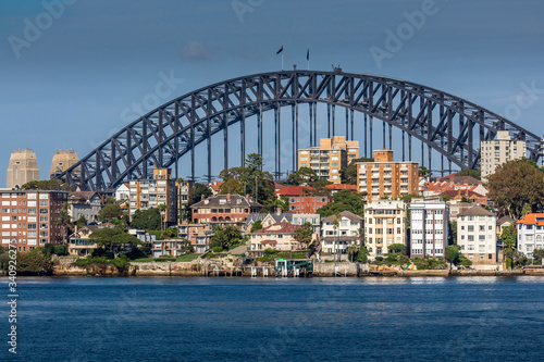Sydney, Australia - 10th February 2020: A German photographer visiting Sydney in Australia, taking pictures of the skyline with the Harbour Bridge during a cloudy but warm day in summer.