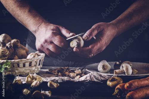 Fototapeta Cropped Image Of Chef Cutting Mushroom On Table