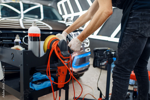 Fotografiet Worker, polishing machine and tools, car detailing