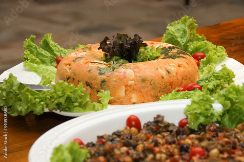 Photo natural couscous salad of corn flour, eggs, olives, decorated with cherry tomato
