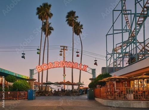 Fototapeta Beach boardwalk with an amusement park taken in Santa Cruz, CA