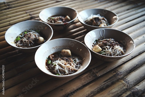 Cuadros en Lienzo High Angle View Of Foods Served In Bowls On Bamboos Table