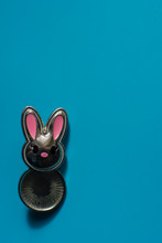 Pretty Silver Bunny On A Vivid Blue Background As Holiday Greeting Card. Place For Congratulations. Romantic Banner. Copy Space.