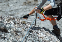 Climbing Along A Steel Line On The Via Ferrata Route In The Dolomites