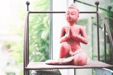 Red Buddha Figurine