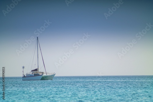 Leinwand Poster Catamaran Sailing In Sea Against Sky