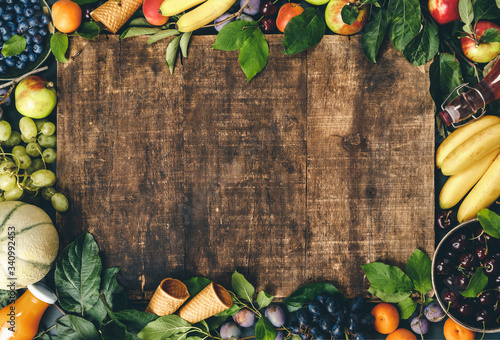Flat-lay of organic fruits and berries and Freshly blended fruit smoothie on rus Wallpaper Mural
