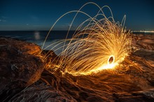 Light Painting At Sea Shore Against Sky During Night