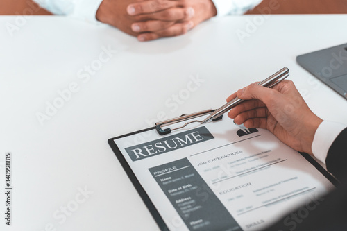 Fototapety, obrazy: Employer or HR department is reading the resume and interviewing the ability of new employees, Employer is selecting job applicants, Employment and Recruitment Concept.