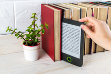 Woman Hand Takes E-reader From...