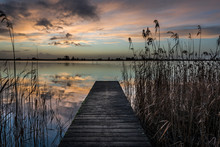 Jetty In Lake Against Sunset Sky