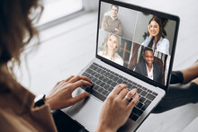 Online Business Meeting. Business Team Working From Home In A Video Conference. .The Girl Communicates Via Video Call Communication Using Laptop With Her Business Colleagues About The Future Strategy