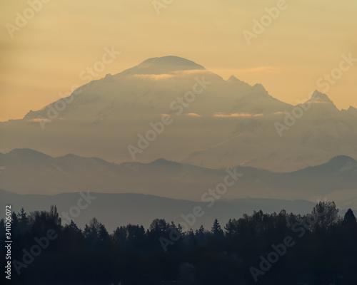 Sunrise orange mountain in the fog