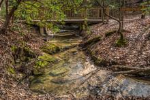 Creek Flowing Under A Bridge