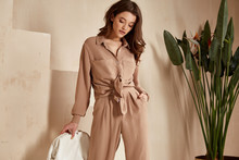 Beautiful Brunette Woman Natural Makeup Wear Fashion Clothes Casual Dress Code Office Style Total Beige Blouse And Pants Suit, Romantic Date Business Meeting Accessory Bag Interior Stairs Flowerpot.