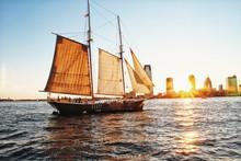 Sailing Ship During City Sunset