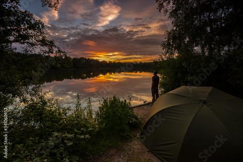 Fototapeta Carp fishing at sunset on a large lake obraz