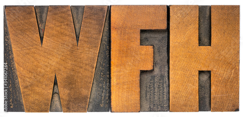 Photo WFH (work from home) acronym in wood type