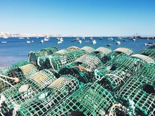Lobster Traps With Boats In Sea