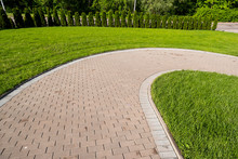 Curved Stone Walkway From Pavers In Landscape Design And Sidewalk Decoration