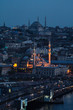 Yeni Cami Mosque By Buildings In City At Dusk