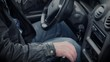 A man starts his car, turns on a manual gearbox and a car radio and starts moving the car. Close-up of the outside of a dirty car.