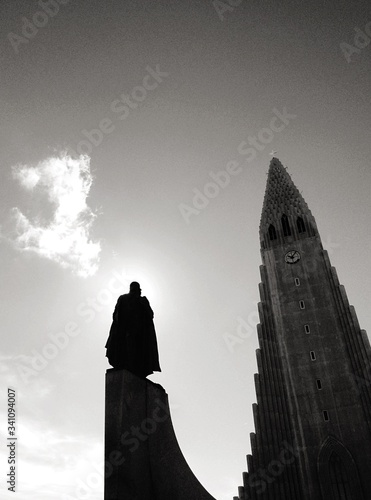 Low Angle View Of Silhouette Statue By Hallgrimskirkja Against Sky Tapéta, Fotótapéta