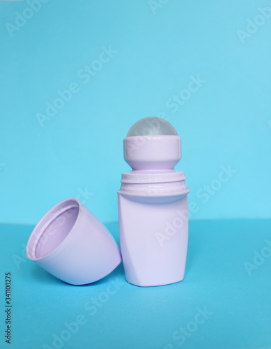 White bottle with Body antiperspirant deodorant roll-on on blue background Canvas Print