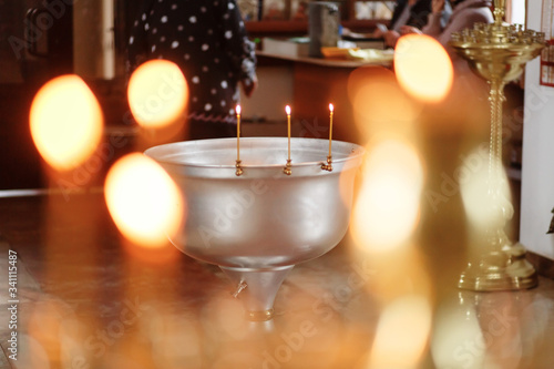 the baptismal font in a candle lights Canvas-taulu