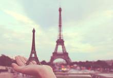 Hand Holding French Souvenir In Paris