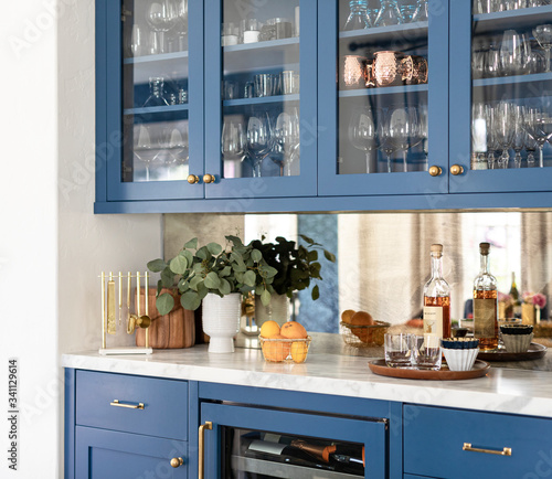 Fototapeta Kitchen cabinet with kitchenwares