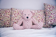 Close-up Of Teddy Bear On Bed