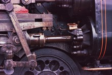 Close-up Of Steam Train Wheel And Engine