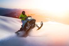Adventurous Man Riding A Snowm...