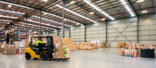Forklift Working At Logistics Warehouse
