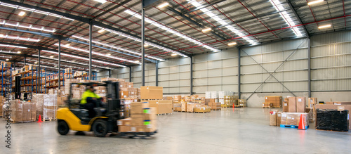 Fotografía Forklift working at logistics warehouse