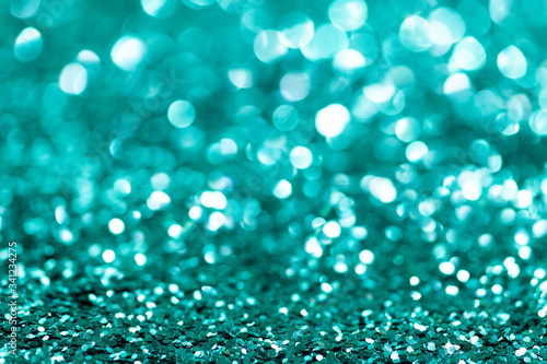 Shiny turquoise glitter textured background