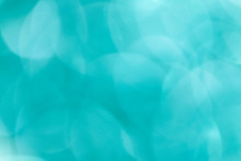 Shiny Blurry Turquoise Glitter Textured Background