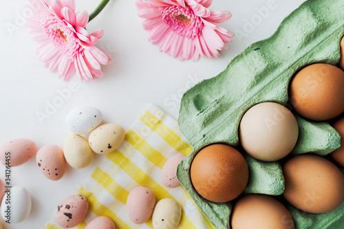 Easter eggs and pink gerbera spring flatlay Wallpaper Mural