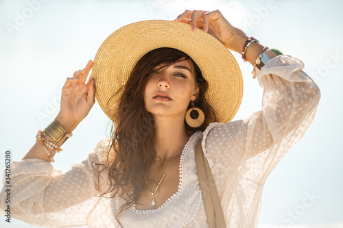 Foto Woman Resting on the Beach During Vacation