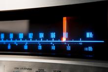 Classic Radio Tuner Panel Close-up. Black Background