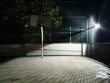 Illuminated Basketball Court At Night
