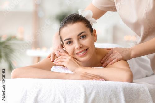 Carta da parati Beautiful young woman receiving massage in spa salon