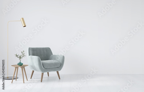 Fotografía Interior composition with a soft armchair, a table and a golden lamp